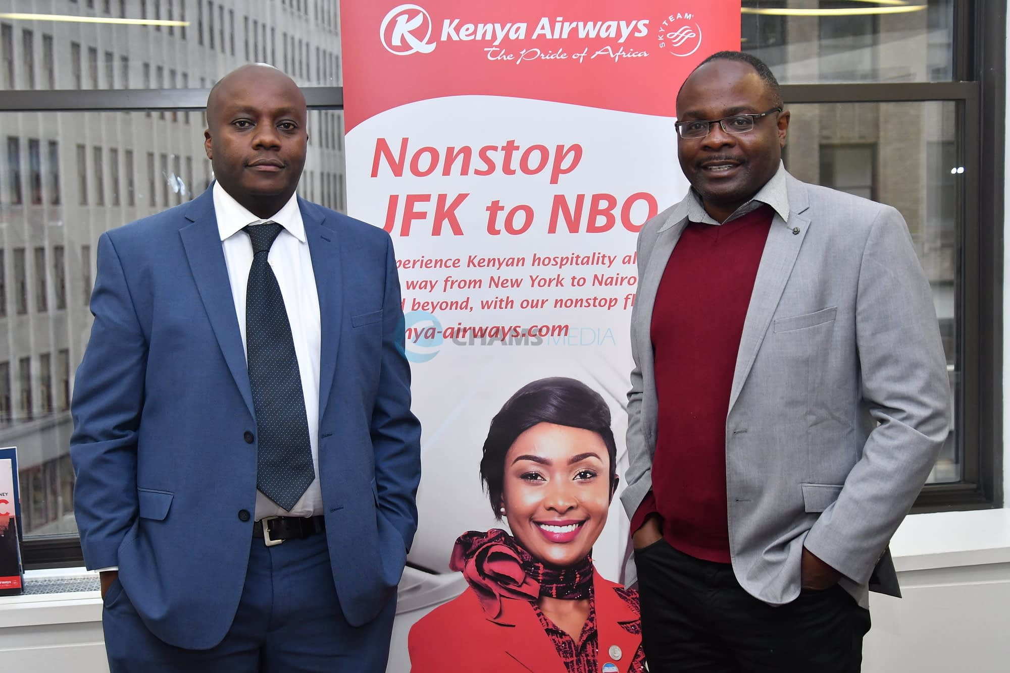 CHAMS Media CEO Alex Chamwada with KQ Manager for USA Stephen Ngamu