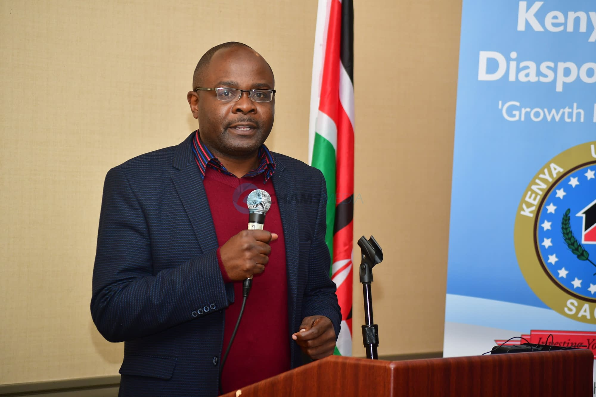 CHAMS Media CEO Alex Chamwada addressing Kenya-USA Diaspora Sacco AGM In Seattle City, June 2028